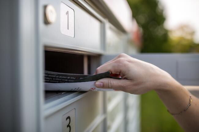 taking mail out of mail box