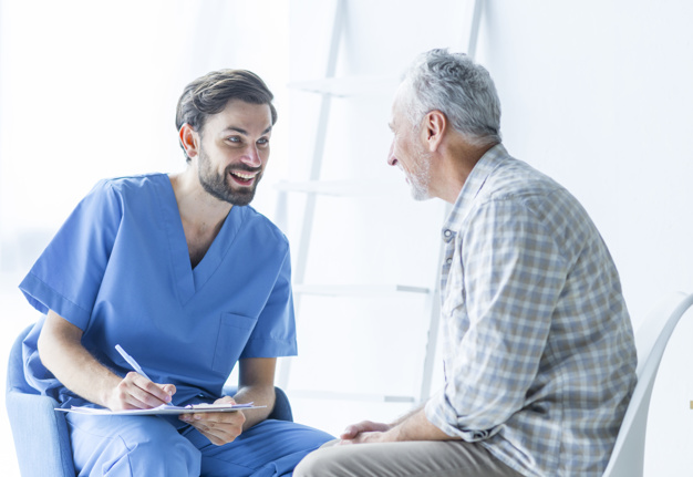cheerful-doctor-talking-with-elderly-patient_23-2147896869